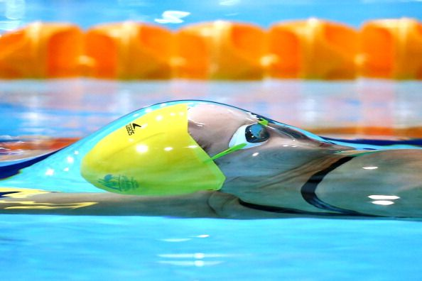 GLASGOW, SCOTLAND - JULY 25: Belinda Hocking of Australia competes in the Women's 100m Backstroke Heat 2 at Tollcross International Swimming Centre during day two of the Glasgow 2014 Commonwealth Games on July 25, 2014 in Glasgow, Scotland. (Photo by Quinn Rooney/Getty Images)