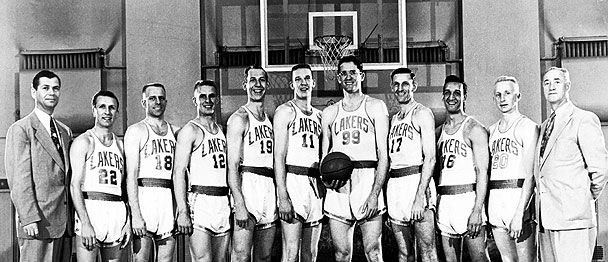 Coach John Kundla (left) with the Lakers, including George Mikan (with ball). 1952-1953
