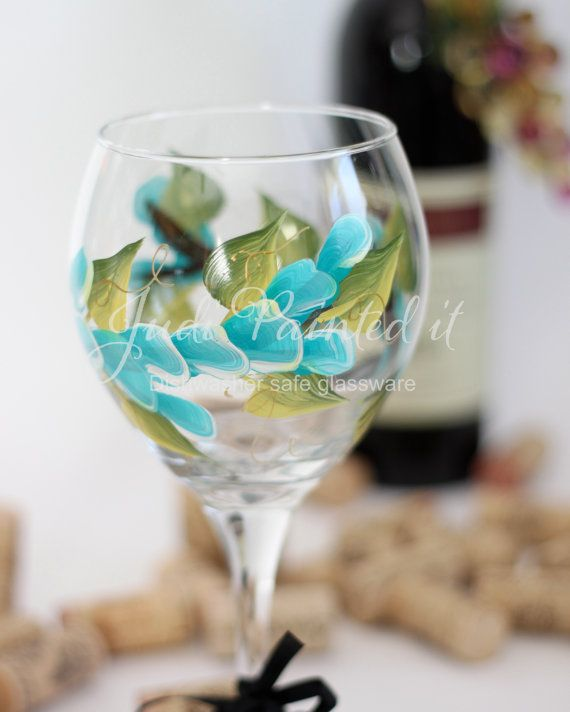 Hand painted wine glass in a aqua wrap around by JudiPaintedit