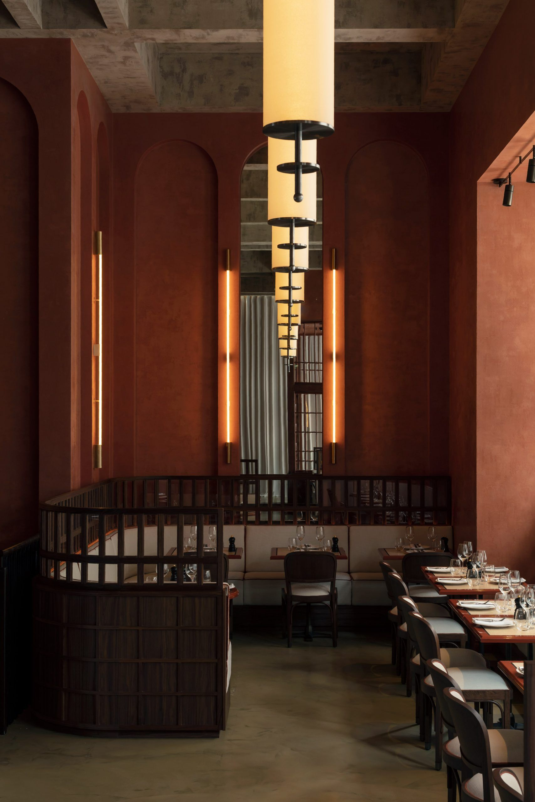 Soaring Arches Reminiscent Of Those Seen In Ricardo Bofill S La Fabrica Feature In This Decade In 2020 Polished Concrete Flooring Restaurant Interior White Brick Walls