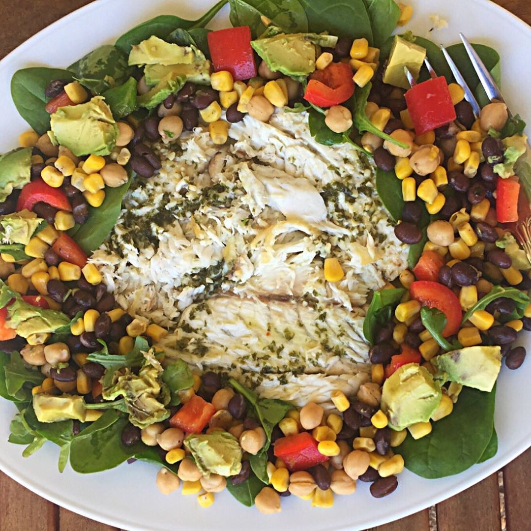 Tender and flaky baked Mahi Mahi with a lemon herb sauce, along with garbanzo beans, corn, avocado, and black beans!! This meal is so satisfying with both animal and plant based proteins, and the added bonus of omega-3 fatty acids from the Mahi Mahi! ————————————————
