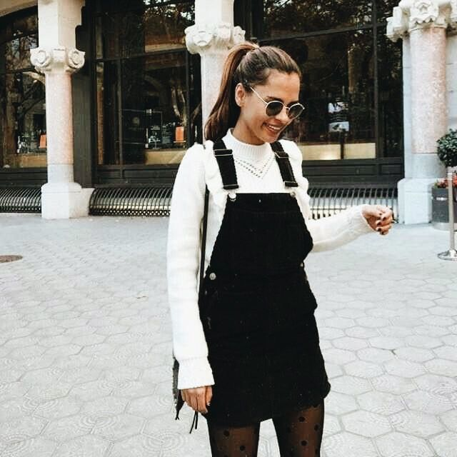 b5fb1c219ff White knit sweater and black dungaree dress. With stockings. Love this fall  outfit idea.