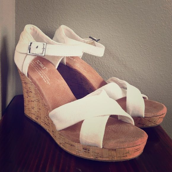 Never Worn TOMS Cork Strappy Wedges Never worn before TOMS natural woven women's cork Strappy wedges. TOMS Shoes Wedges