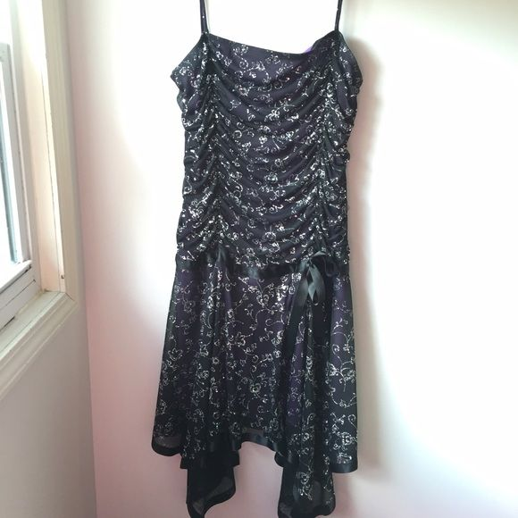 Purple Sparkle Homecoming Dress Only worn once. Stretchy material. Purple with black overlay. Beautiful vine-like sparkle design. Feel free to make a reasonable offer! Deb Dresses