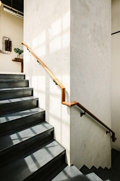 Emerick Architects   The Concrete Stair Treads And Steel Risers Wrap Around  The Hand Plastered Elevator Shaft.