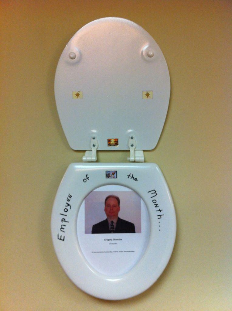 Boss got a toilet seat as a white elephant gift white