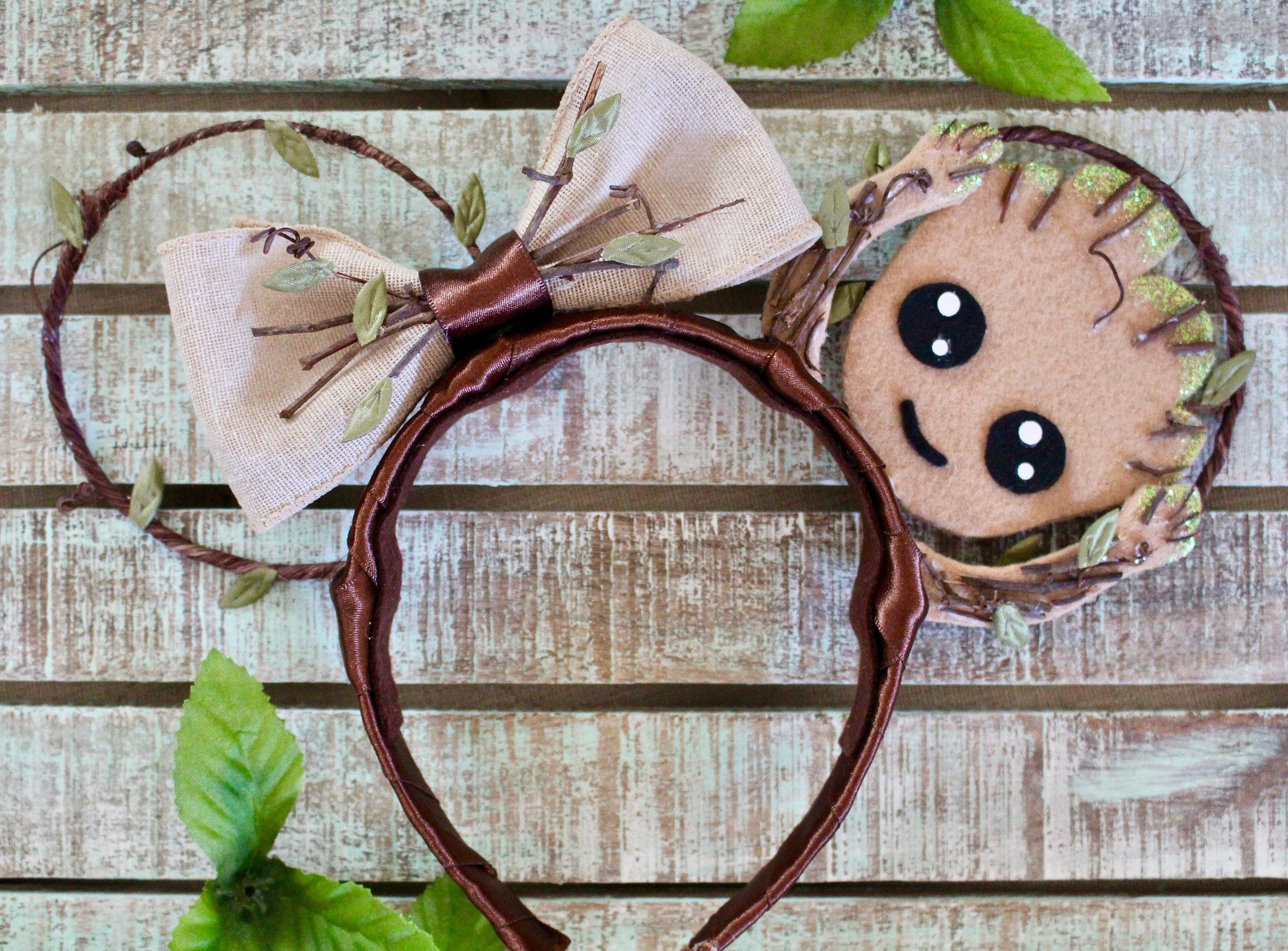 This Baby Groot pair has a cut-out ear AND a bow.