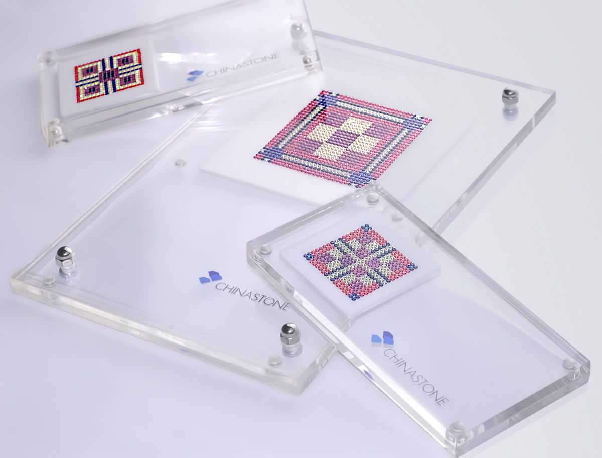 This stylish and bold art deco pattern set was made primary in mixture of lavender and orange colors and contains 1,445 precision-cut natural gemstones, including 148 pcs of Blue Sapphire, 268 pcs of Lavender Sapphire, 809 pcs of Yellow Sapphire and 220 pcs of Black Sapphire.    http://www.thechinastone.com/products/search-results/keywords-00109789-00113670-00116145-00119887-00129800/10/0