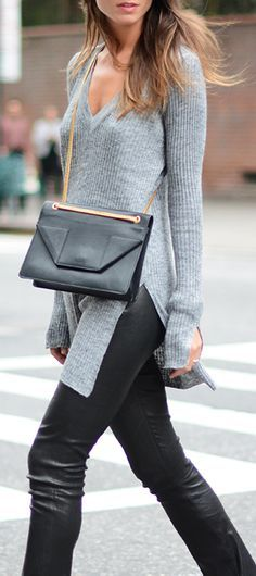 Grey sweater split down the side with leather pants and a leather cross body bag. Love this look for fall.