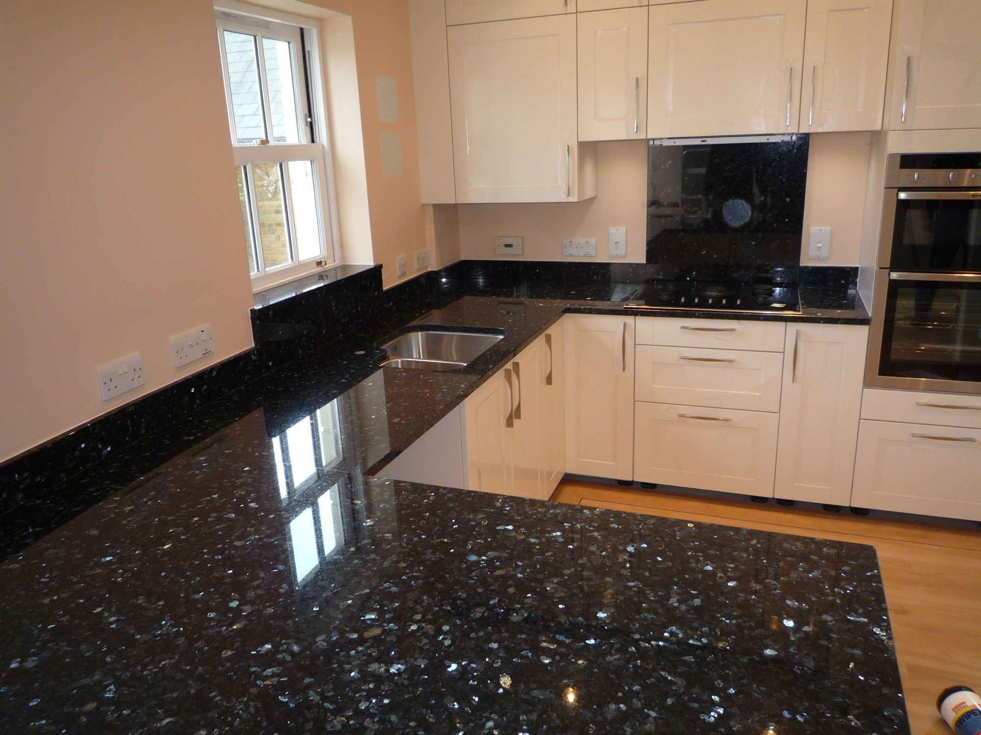 White kitchen cabinets with emerald pearl granite - Granite Worktops Countertops From Shaw Stone Hampshire