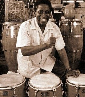 Aver ammirato Mongo Santamaria in suo concerto significa aver visto uno spettacolo per vista e per udito. Mongo è stato un percussionista cubano pieno di energia legata al ritualismo magico della sua isola. La sua musica vitale e piena di energia è stata...