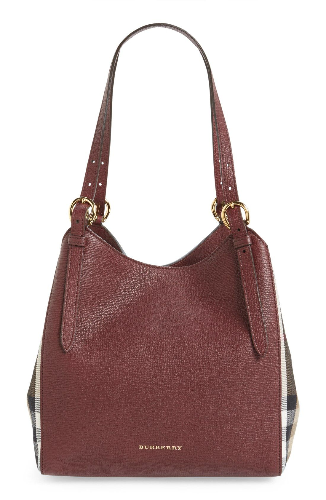 8437afeb9bed Side panels in Burberry s House check add extra flair to this tote s soft