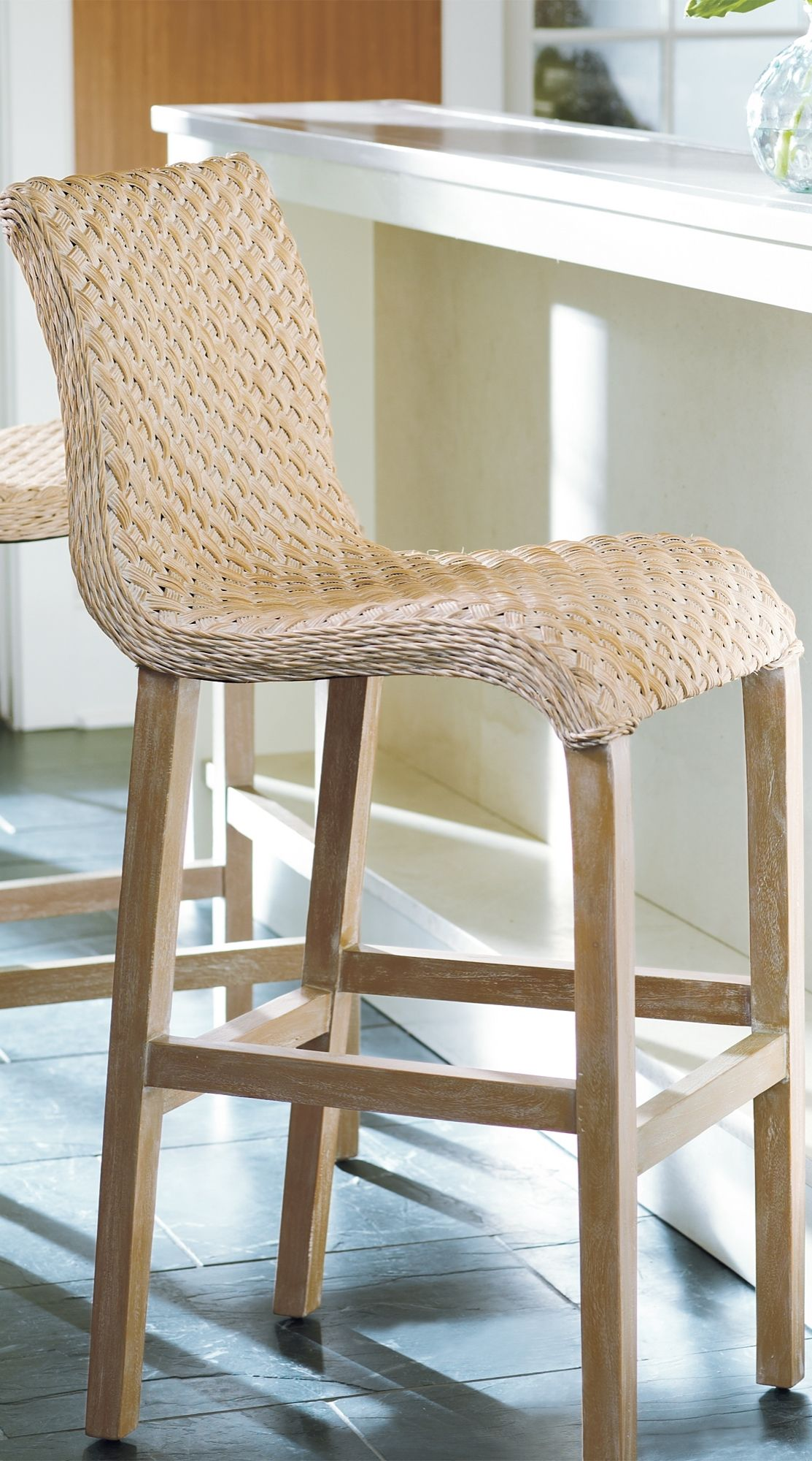 Pull up one of our gracefully flowing Sanders Wicker Barstools, and ...