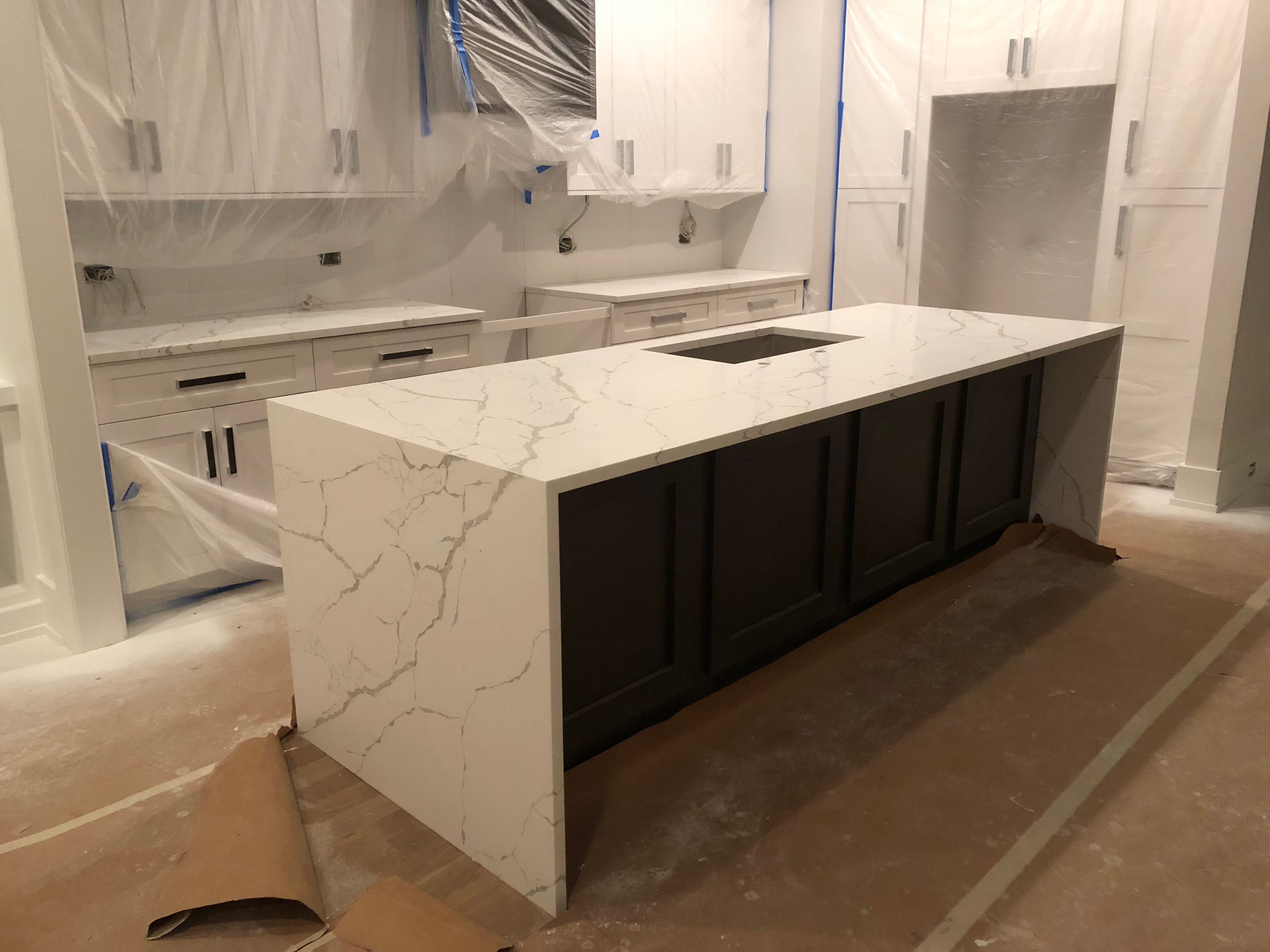 Calacatta Laza Quartz From Msi With Waterfall Panels And Vein