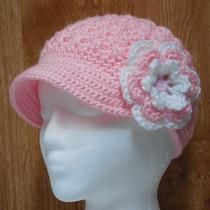 pink hat with a flower.