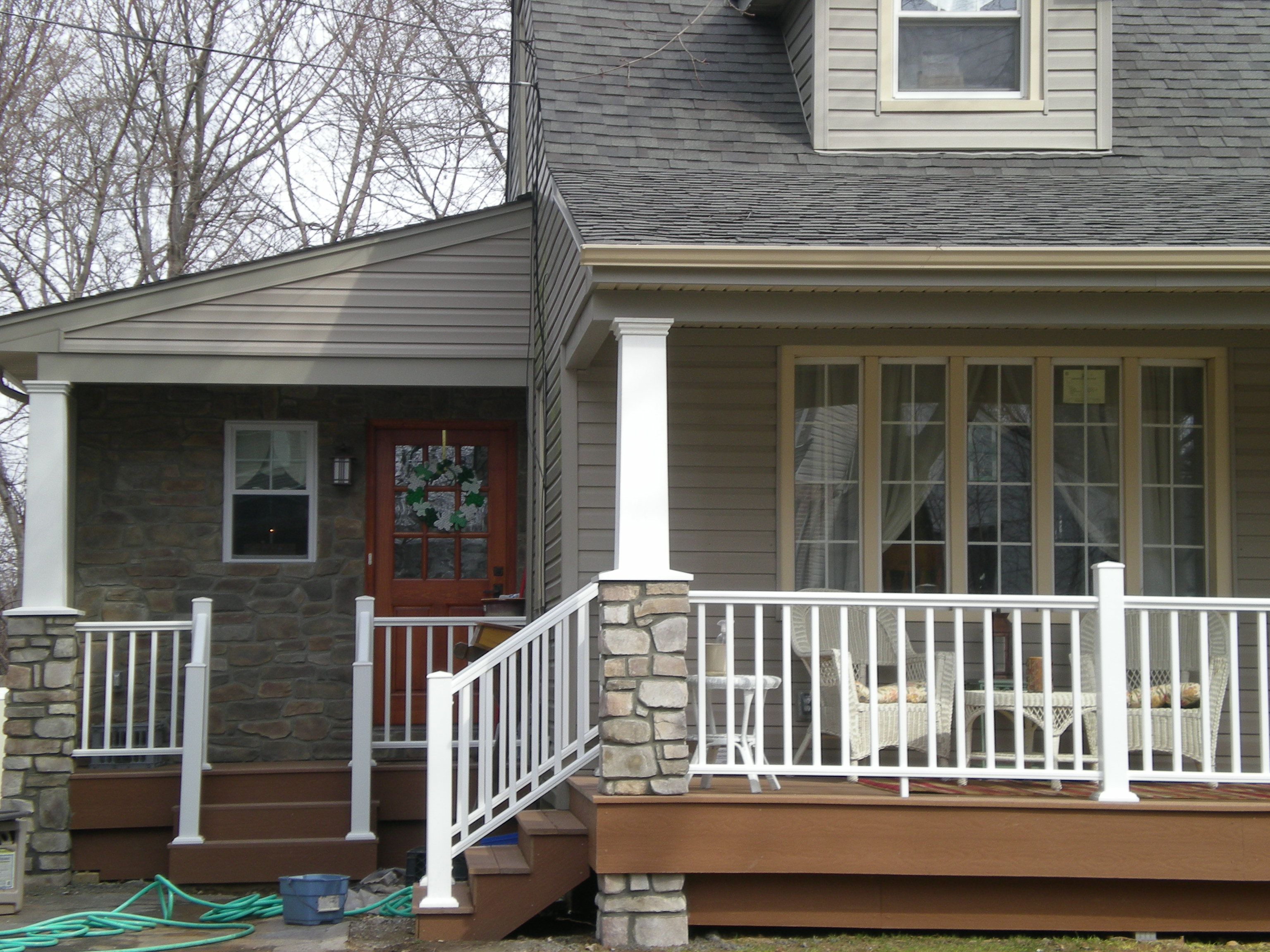 New side entry and front porch with new stone work pavers for Front entry decks
