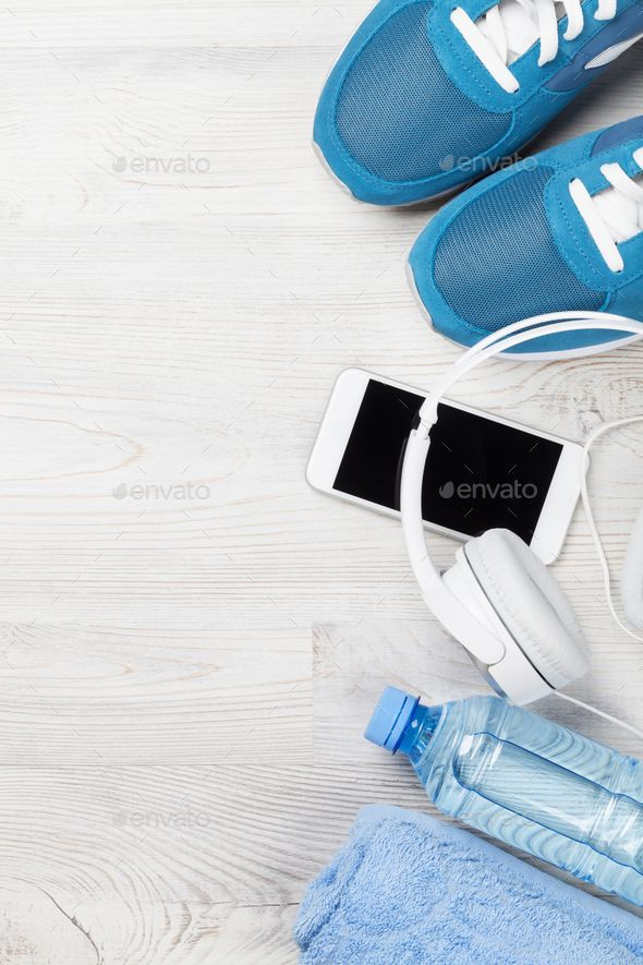 Fitness concept background by karandaev. Fitness concept background with sneakers, smartphone, water...