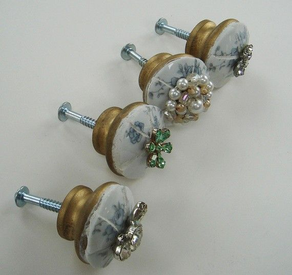 """This set of 4 knobs measure 1-3/4"""" in diameter and can be used on any cabinet door to give your item a shabby chic look.  White grout and vintage jewelry pieces were used to decorate the limoge china knobs."""