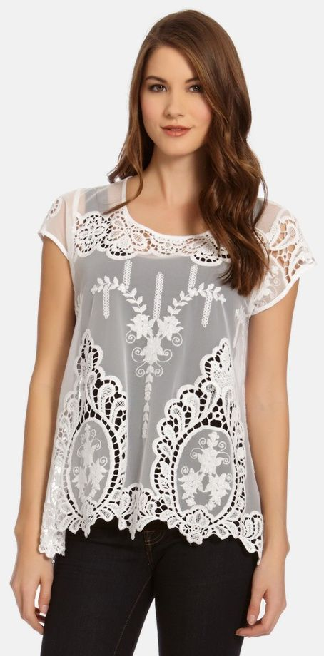 With the look of vintage lace, a scoop-neck top is utterly charming with airy eyelets and lovely embroidered detail at the front and cap sleeves. Lace trim at the floaty asymmetrical hem is a suitably romantic finish.