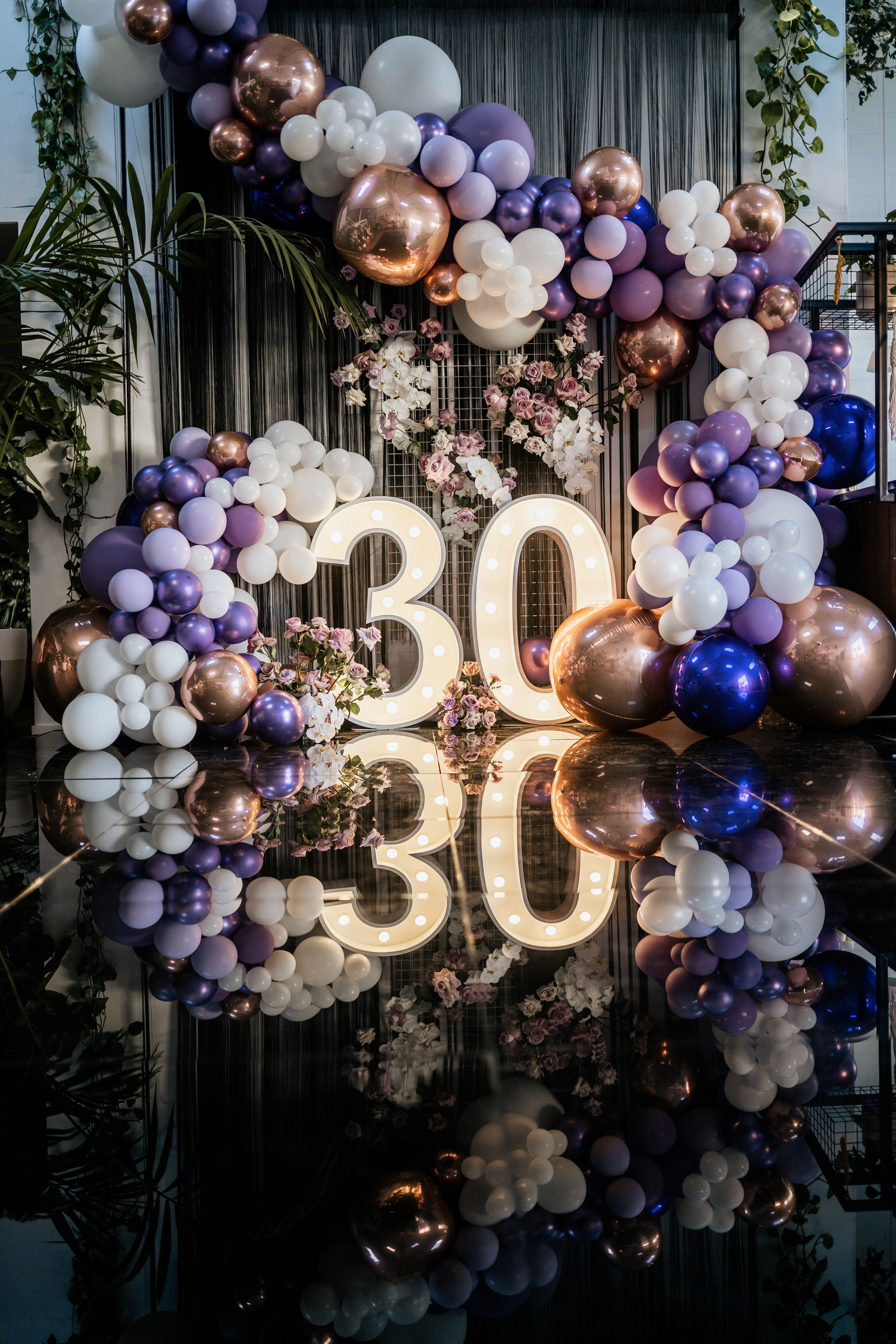 Rose gold, purple and white balloon garland by Stylish