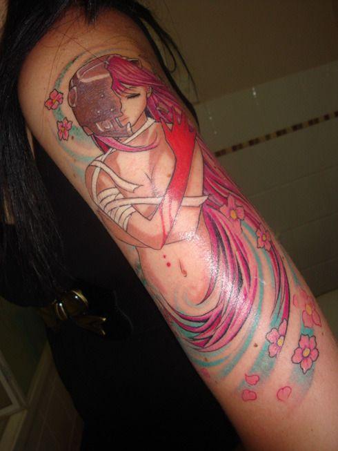 Redhead tailbone tattoo