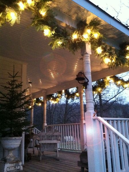 Lighted Outdoor Garland Hanging lighted garland on ceiling of covered porch christmas tree hanging lighted garland on ceiling of covered porch christmas tree in urn workwithnaturefo