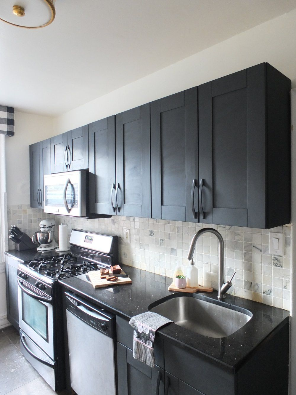 Charcoal Gray Chalk Painted Cabinets With Black Quartz Counters And A White Marble Back Chalk Paint Kitchen Cabinets Small Kitchen Cabinets Chalk Paint Kitchen
