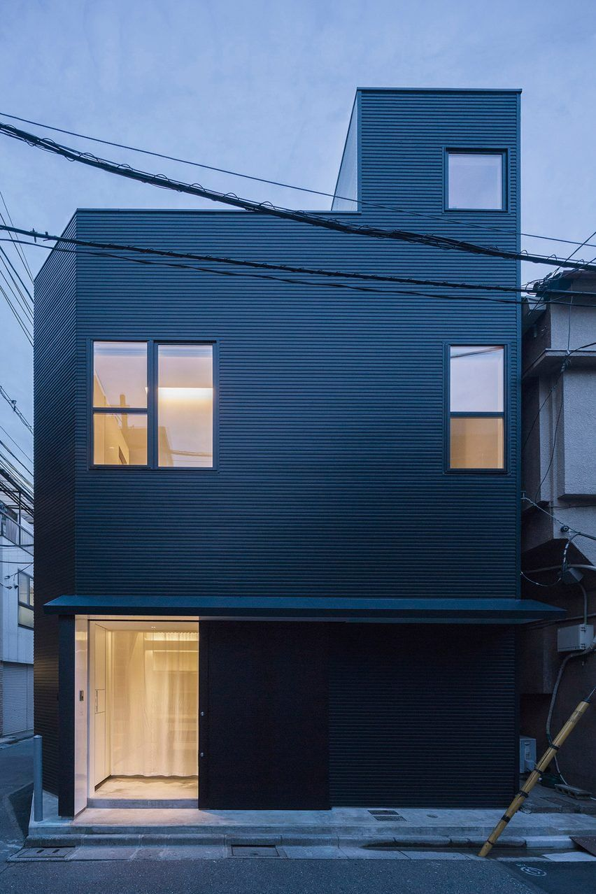 This two-storey residence named House-Is is clad in black corrugated metal and occupies a small plot of land in Tokyo's Koto-ku district.