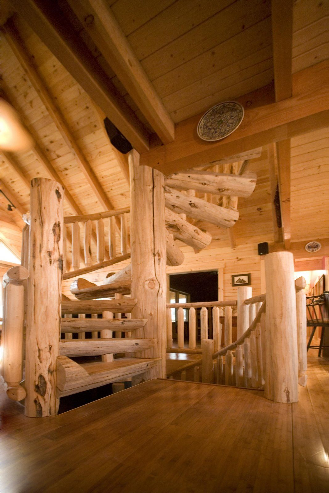 Custom Half Log Spiral Staircase With Hand Scraped Wood Railing To Loft  From Great Room,