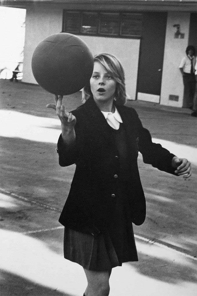 14 year old Jodie Foster showing off her basketball skills in her school uniform at Lycée Français de Los Angeles: