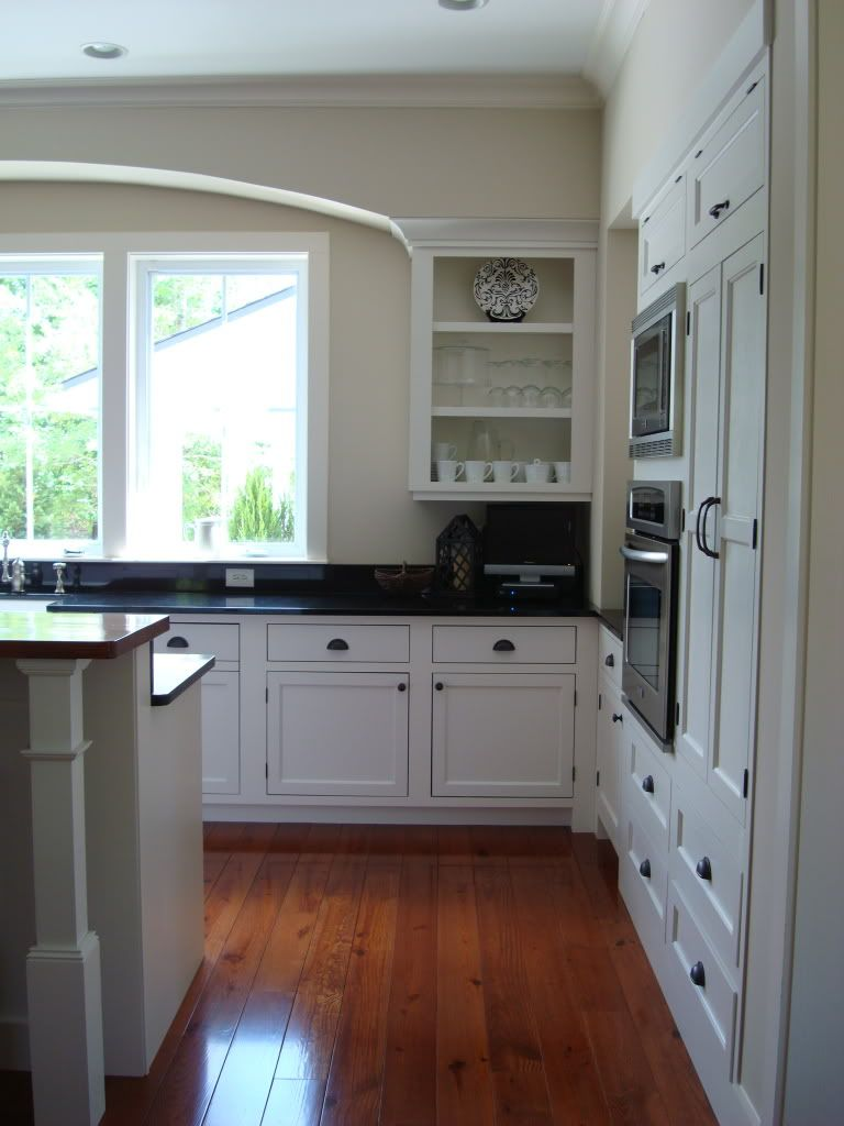 cabinets with no doors frame the sink love the way the crown molding disappears into the arch on kitchen cabinets no doors id=86212