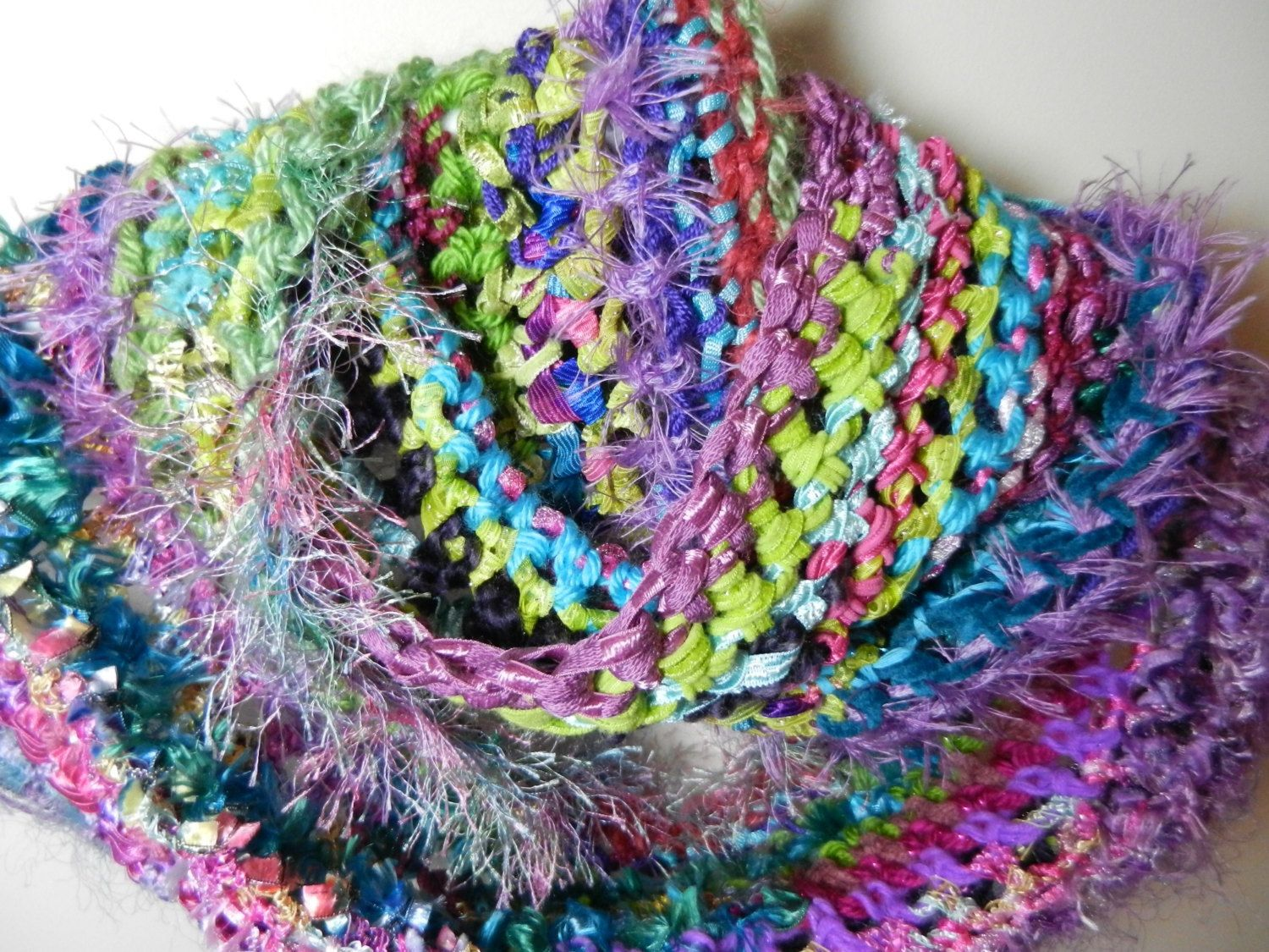 crochet a scarf by tying multiple different textures of yarns and ...