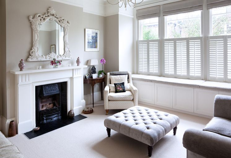 Traditional Living Room Using A Combination Of Shutters And Roman