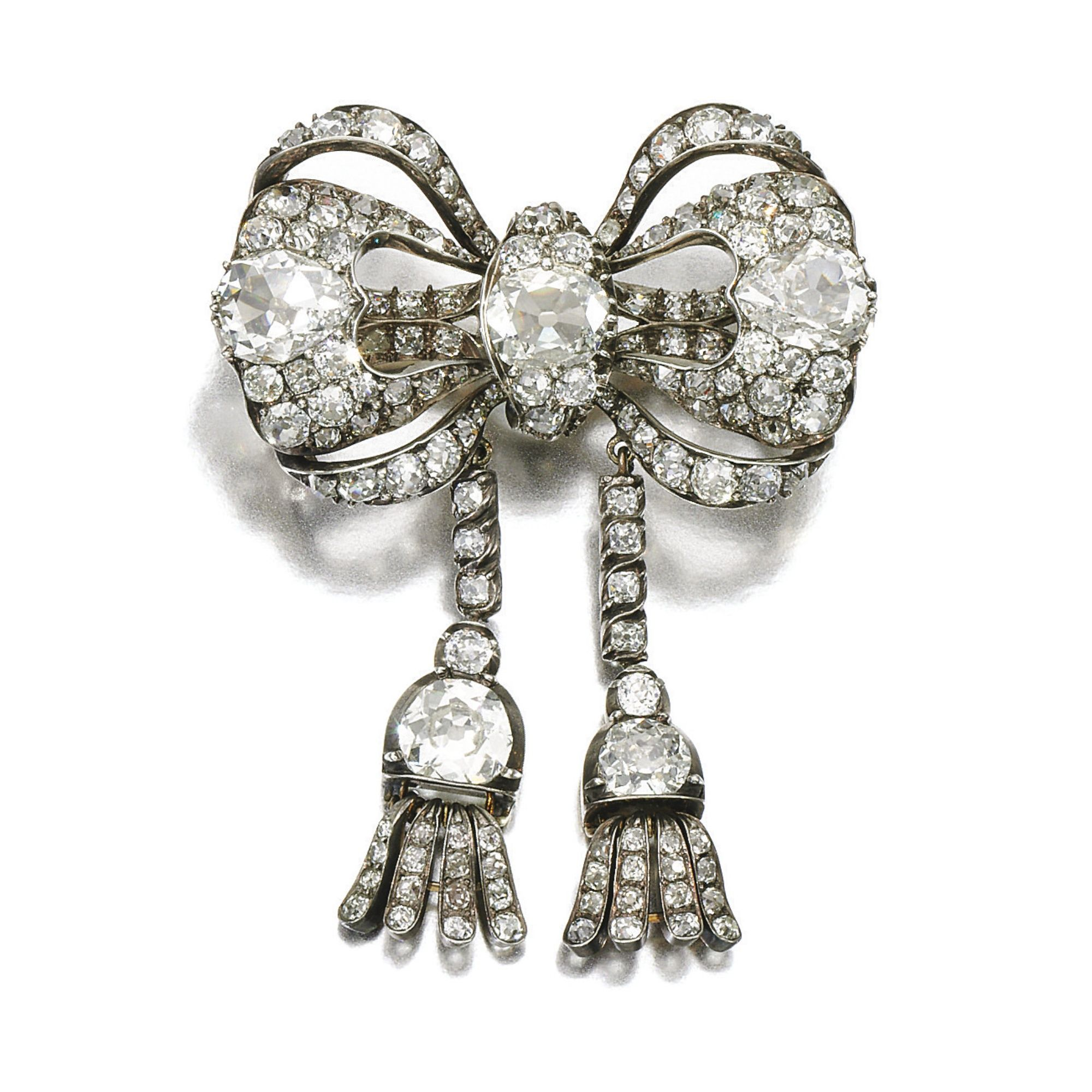 DIAMOND BROOCH, CIRCA 1840 Designed as a bow suspending two tassels, set with cushion-, pear-shaped and circular-cut diamonds, later pin fitting.