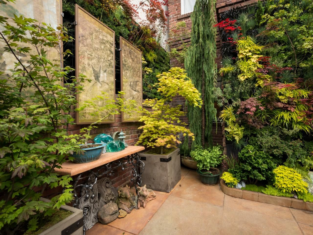 this lush courtyard garden includes potted japanese dwarf maples