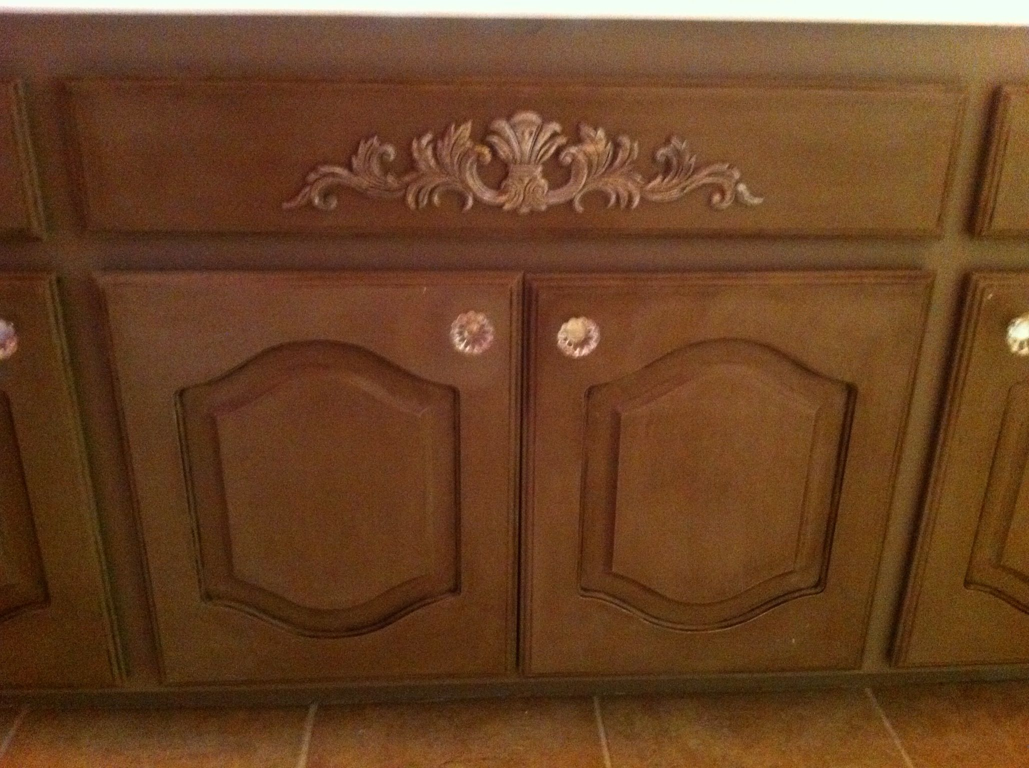 White cabinets turned beautiful with Annie Sloan coco paint with a coat of clear wax and then dark wax.