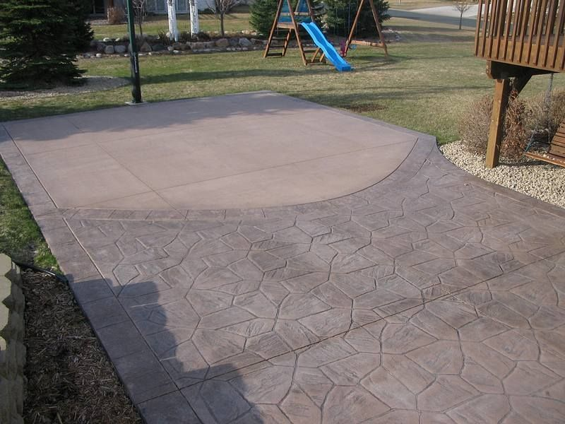 Colored Concrete Basketball Court With A Stamped Concrete