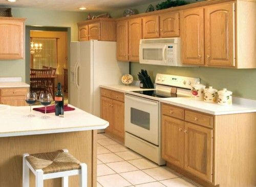 white countertops, white appliances, light wall, white crown molding