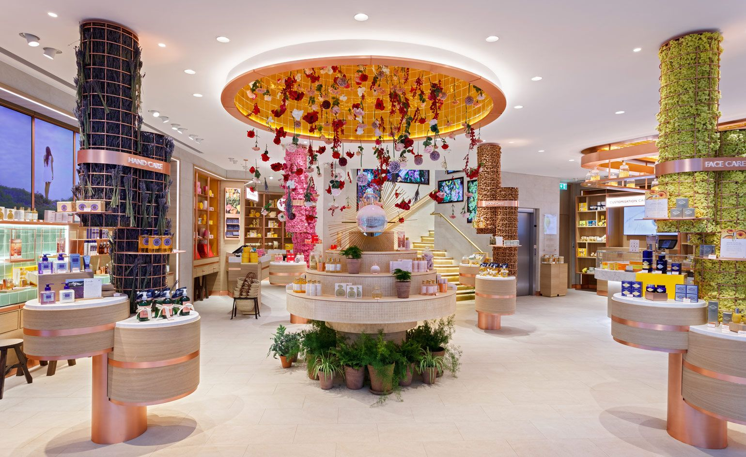 Flowers fall from the ceiling at the new L Occitane boutique in London Shop  Fronts 83d348eccd37
