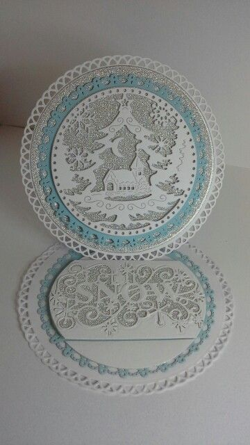 Crafty cardz, A circular easel card created with grand decorative circles one from spellbinders ,tattered lace snow globe and sue wilson let it snow die, please follow me for more creations at http://simplycraftycardz.blogspot.co.uk