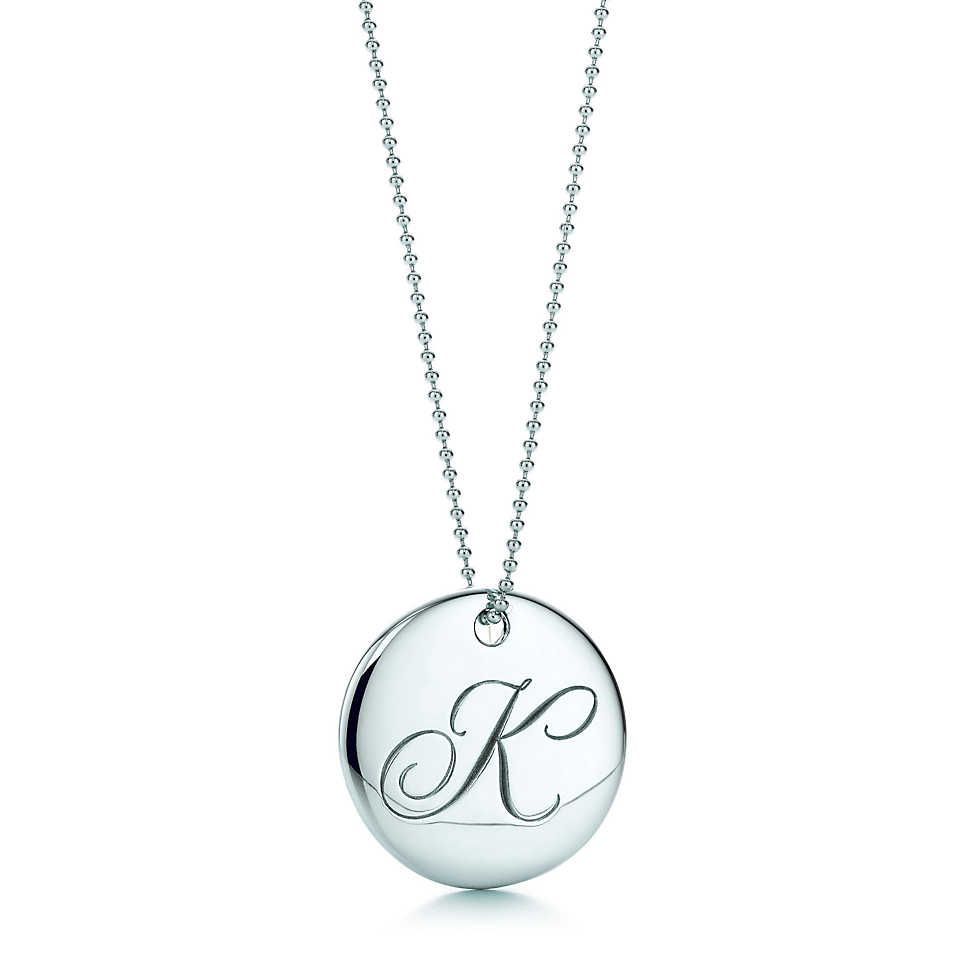 916f1b73c Tiffany Notes letter round pendant in sterling silver. Letters A-Z  available. | Tiffany & Co.