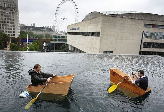 Credit: David Levene The Guardian's Adrian Searle (left) gets to grips with a boating lake complete with dock and three small wooden boats, ...