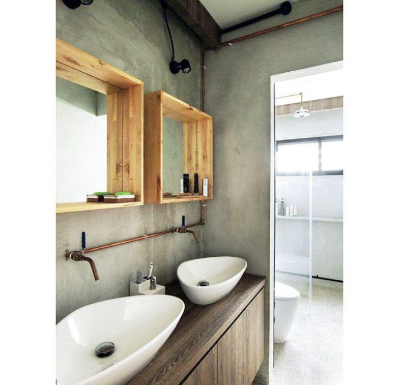 Cuba dupla e espelho duplo caracterizam este banheiro, com paredes de cimento queimado