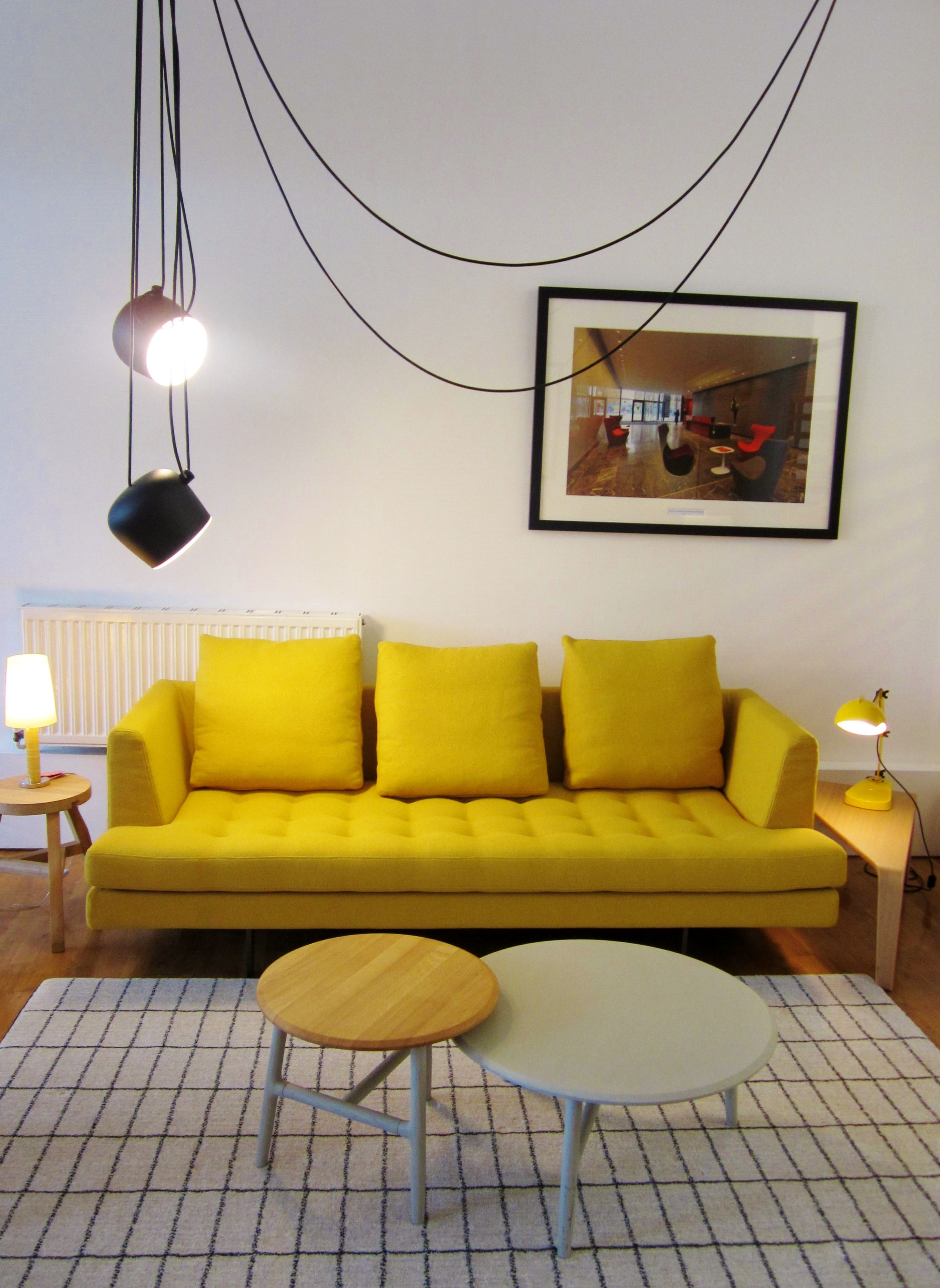 Edward sofa from Bensen with Aim lights from Flos and Nudo side tables from Sancal