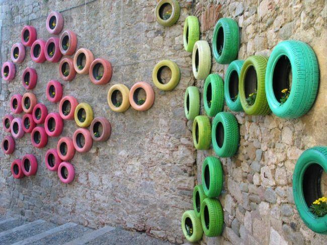 Steindekoration Garten mauerwerk stein dekoration gebrauchte autoreifen bunt als
