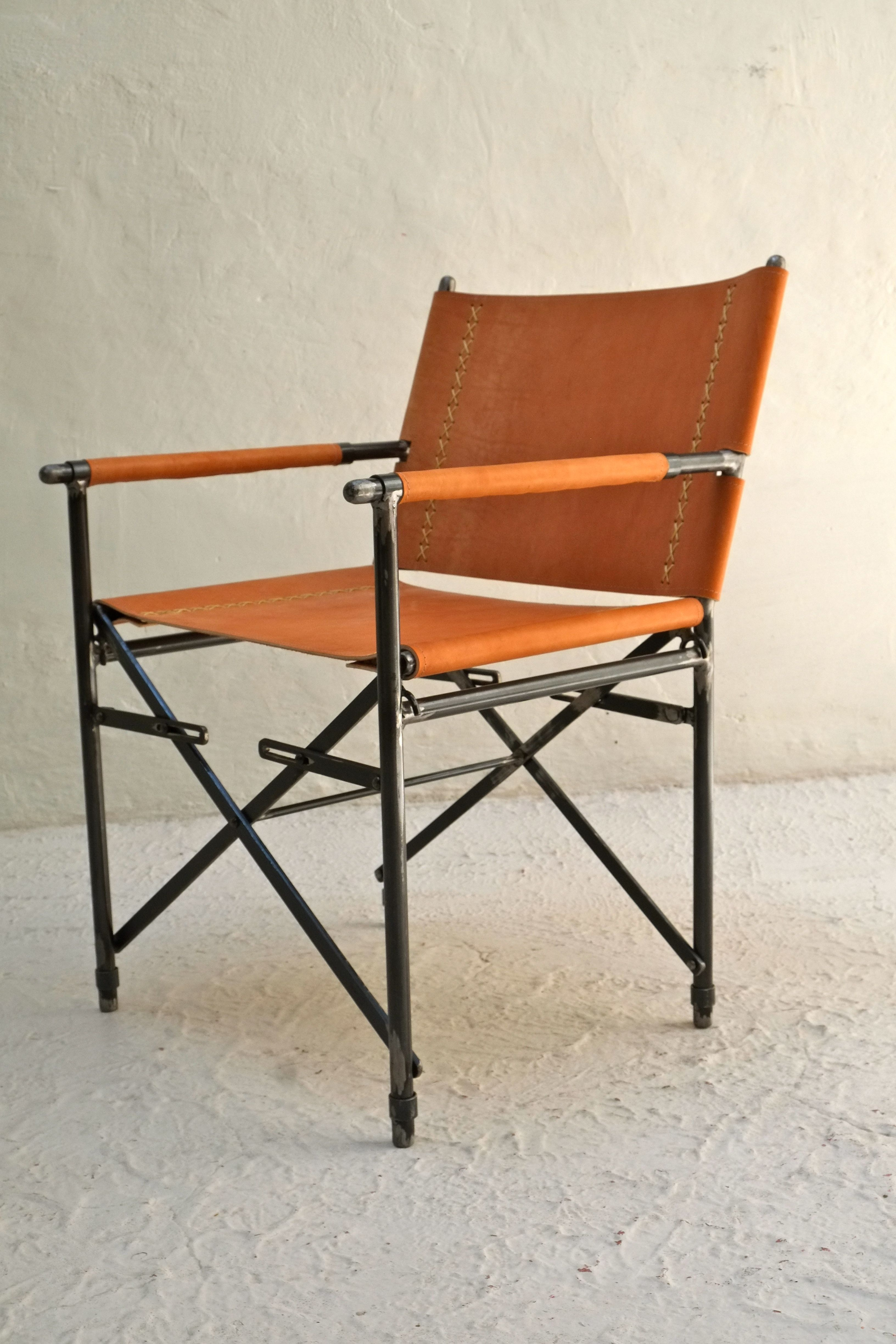 casamidy grena r armchair in saddle leather and wrought iron