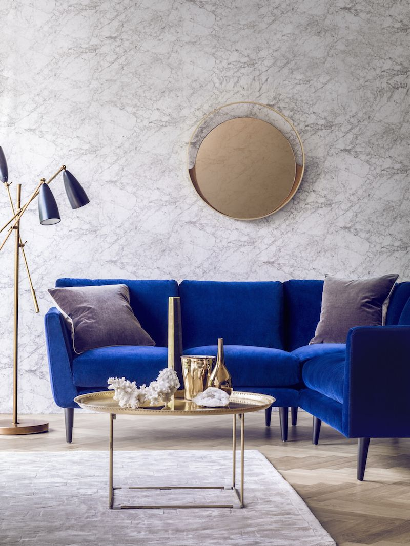 Blue Velvet Sofa (Holly Corner Sofa) With A Gold Coffee Table And Marble  Walls