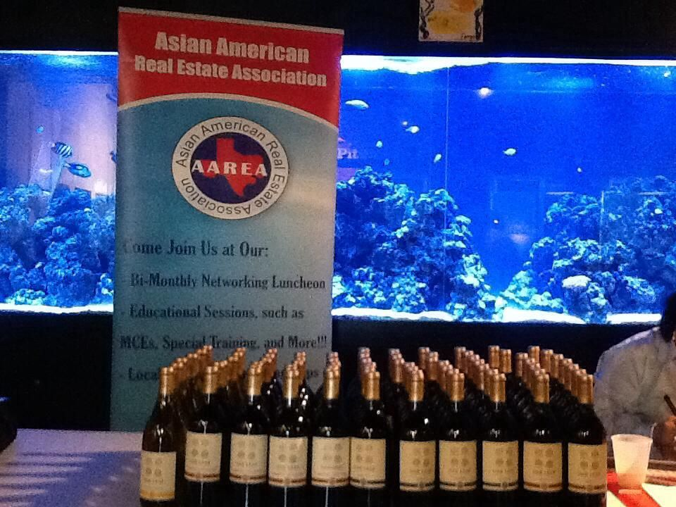 Members and newly join member take home a bottle of wine!  2013 Mixer & Mingle organized by The AAREA - Houston TX. Sponsored by Declaration Declaration Title, Wells Fargo, the Houston Museum of Natural Science & Vicki Lam Realty. — at Houston Museum of Natural Science - Sugar Land.