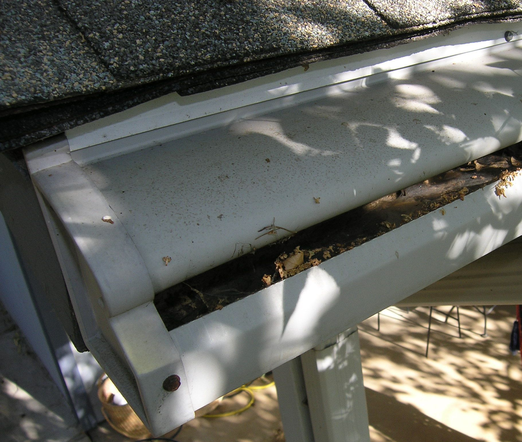 Does This Picture Resemble Your Clogged Gutters This Is The Problem With Old Reverse Curve Surface Tension Techn Gutter Protection Gutter Guard Clogged Gutter