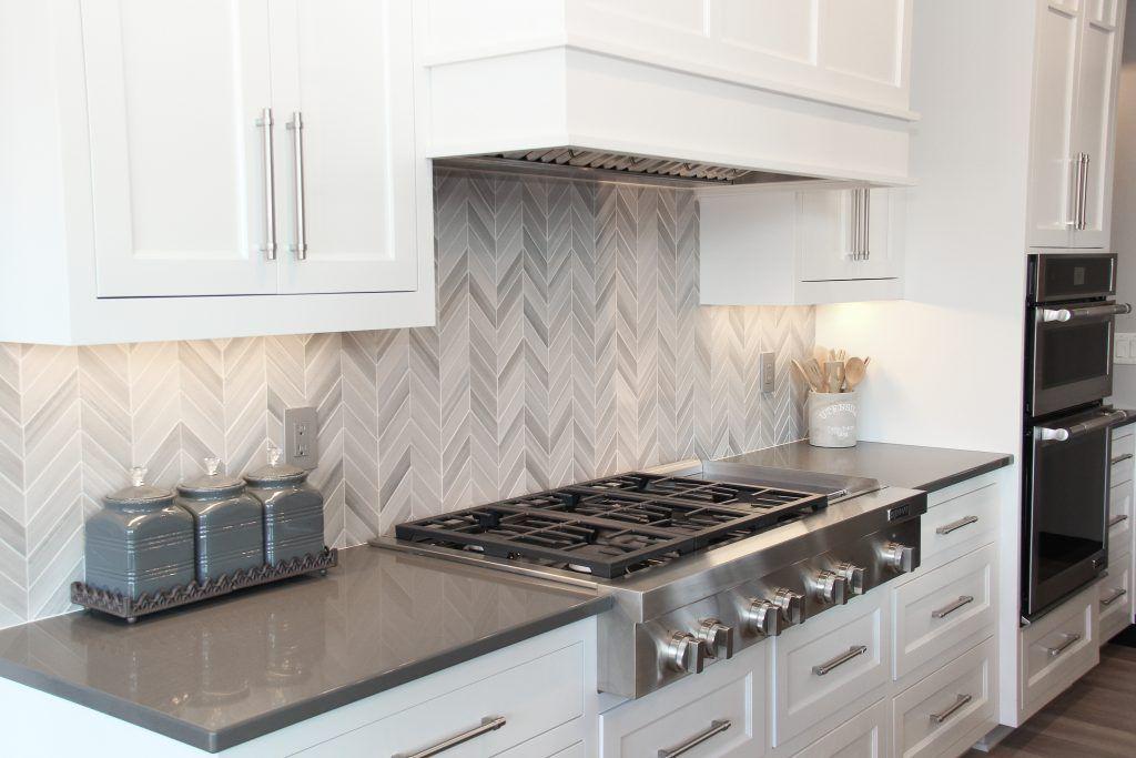 Light Gray Tiled Kitchen Backsplash In Chevron Pattern New